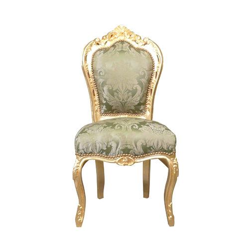 Baroque chair with a green fabric