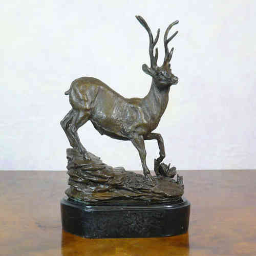 Statue of a stag in bronze