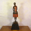 Seller in traditional dress -  Statue in bronze