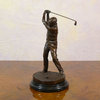 Bronze statue of a golfer