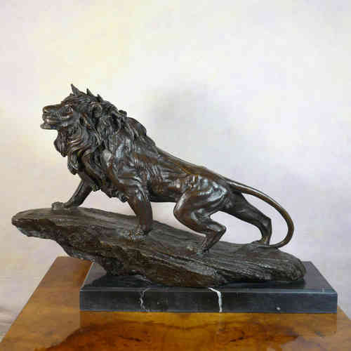 Bronze sculpture of a lion on a rock