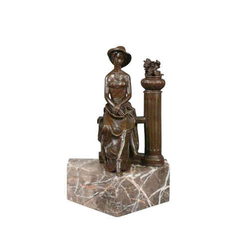 Bronze sculpture of a woman sitting